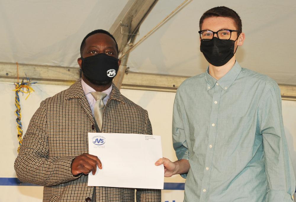 Alexander Pruchnicki (Avon) receives his two scholarships totaling $4,000 from JVS Superintendent, Dr. Glenn Faircloth