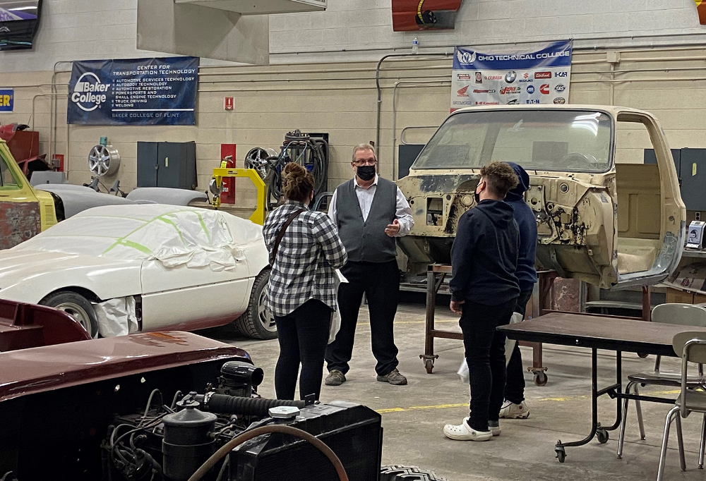 Prospective students and parents talk with JVS collision repair instructor, Lonnie Higey, at the JVS Open House
