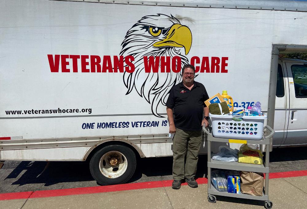 Craig A. Lukes, picks up the donation at Lorain County JVS