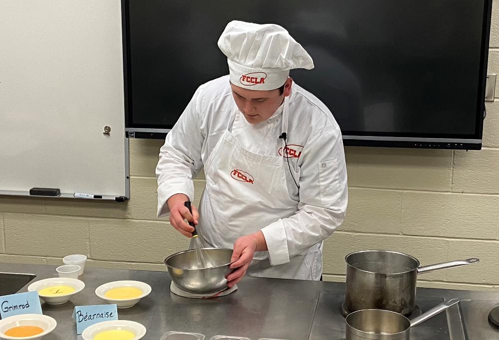 Donavyn Pasters, (Midview) mixes hollandaise sauce, as part of the junior culinary team event.