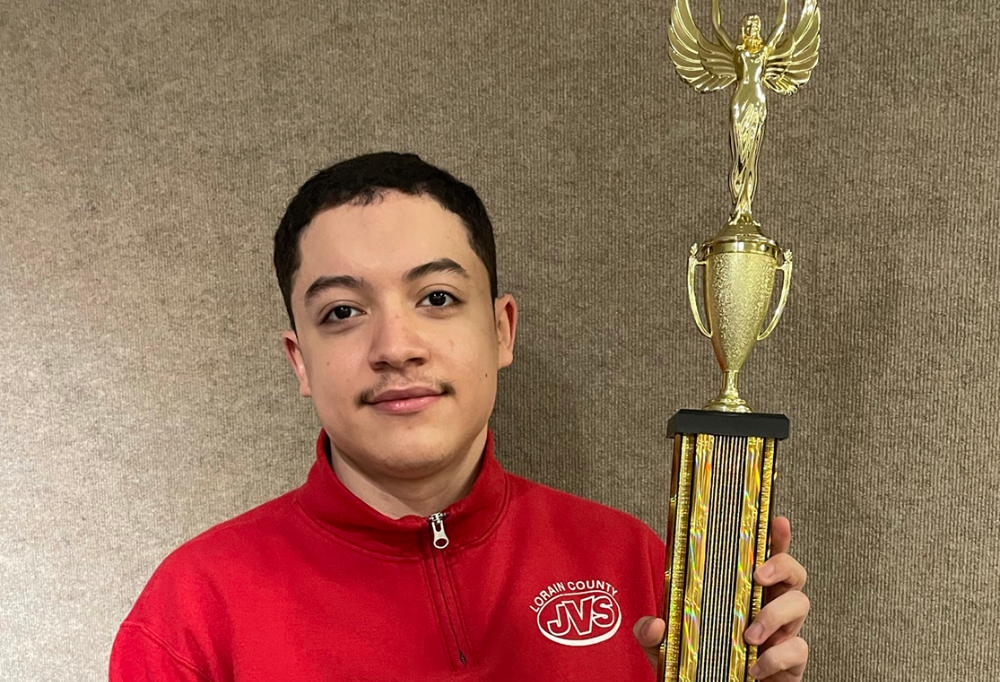 Eduardo Diaz (Firelands) placed 1st in the computer security event and is advancing to nationals and smiles with his trophy