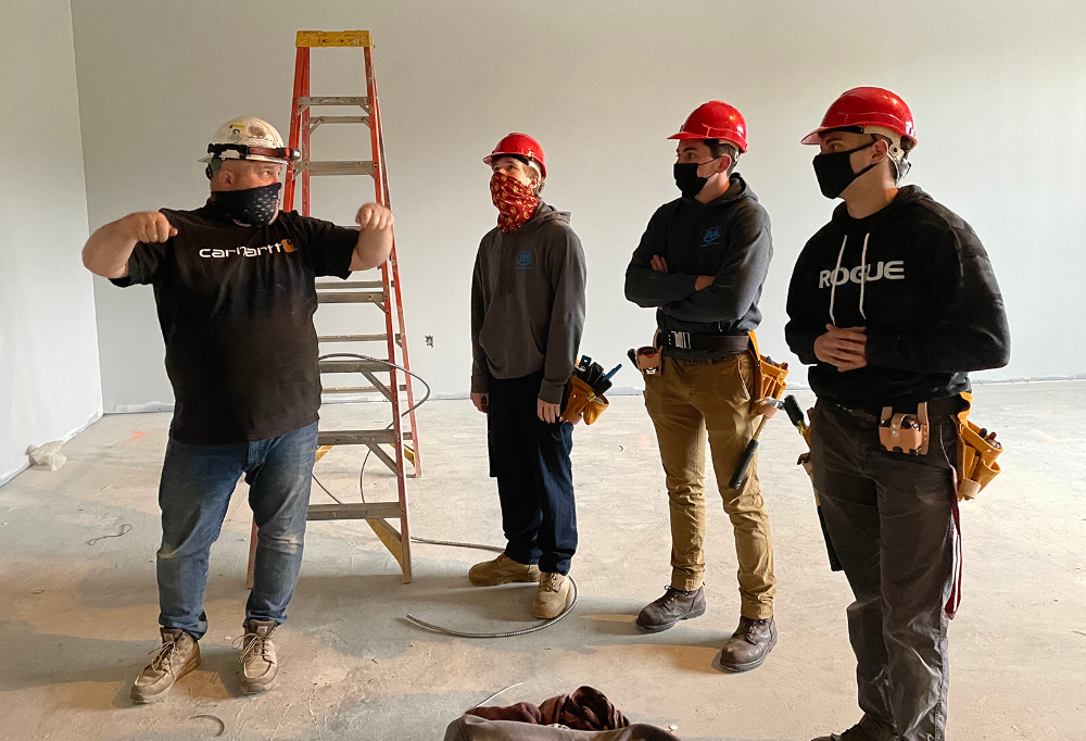 Jason Lamb, foreman with Jim's Electric, talks to Lorain County JVS Industrial Electricity students Edward Shilliday (Avon Lake), Adam Henderson (Amherst) and Kaleb Taylor (Wellington)