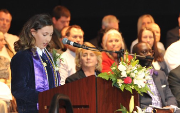 female senior student addresses her graduating class