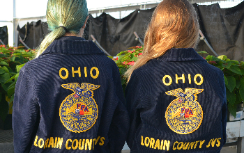Victoria Sprague and Emily Wells show the backs of their FFA jackets