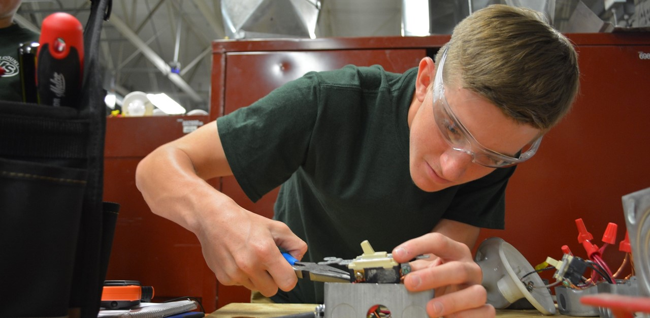 Male student works on basic electrical work in the Heating and Air Conditioning lab