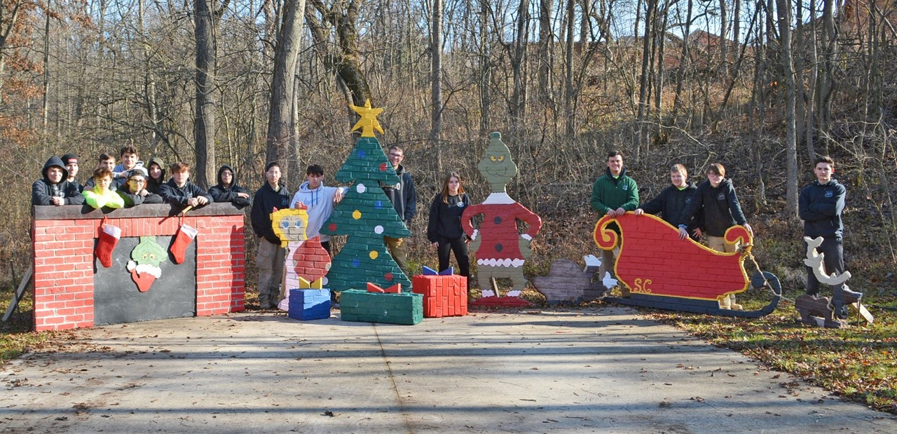 Masonry Trades students stand outsdie by their Holiday Lights display