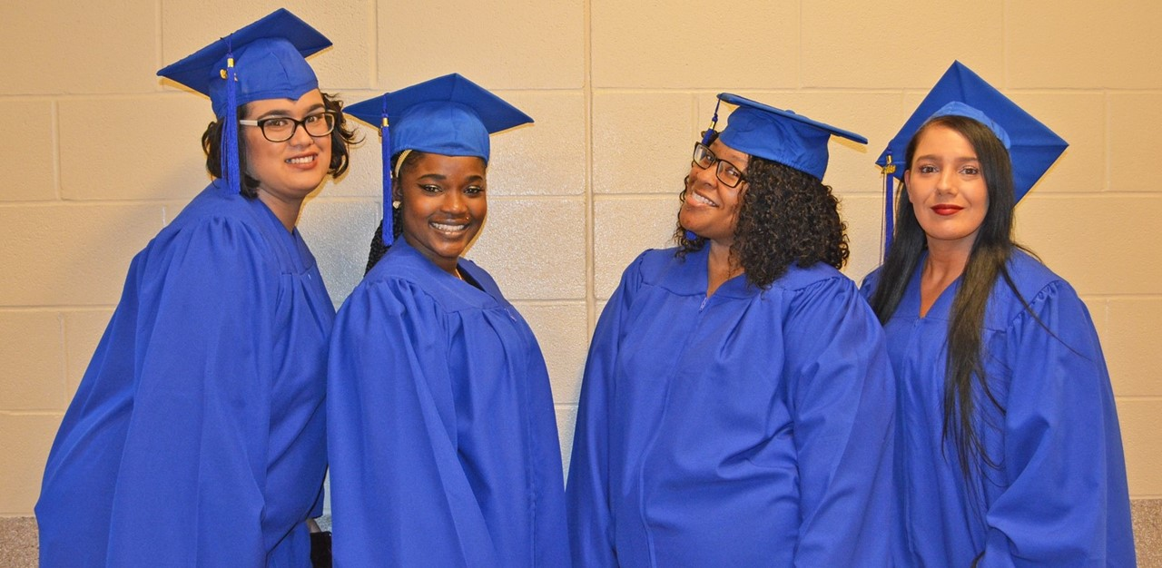 4 female students in cap in gowns