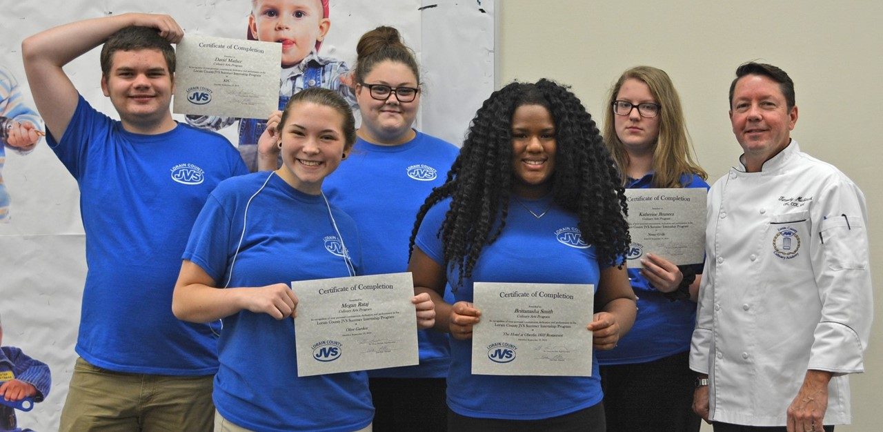 5 summer interns smile with instructor