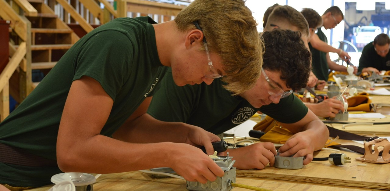 Industrial Electricity Juniors work on basic electrical wiring