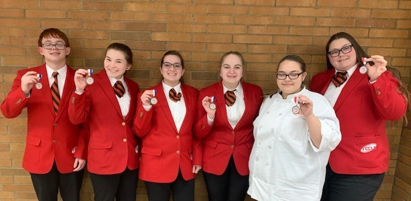 Culinary Academy students smile with medals at the regional FCCLA competition