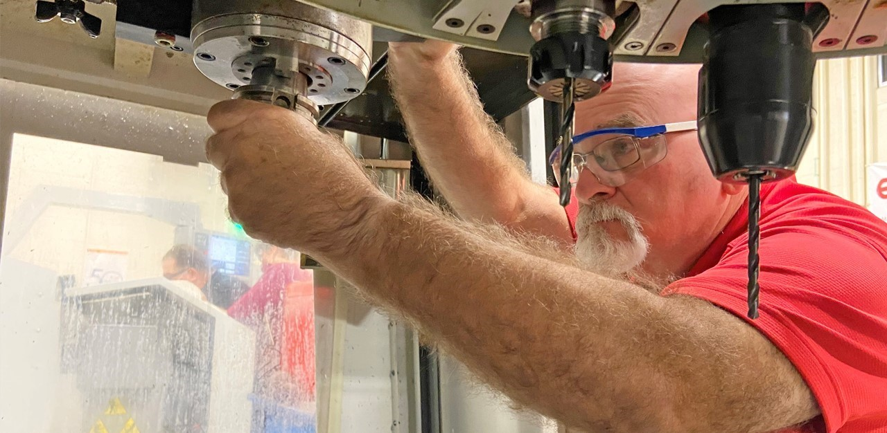 Man works on a CNC machine